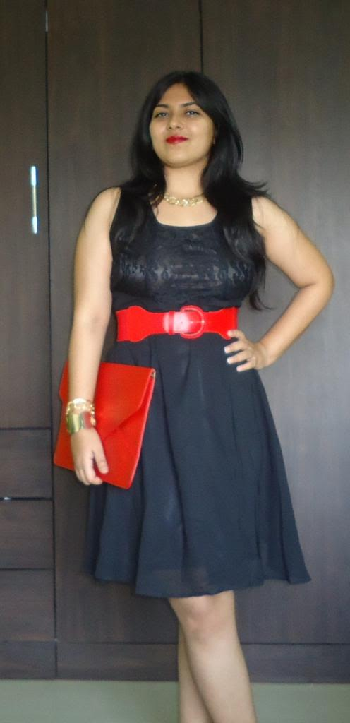 Black dress red belt black shoes
